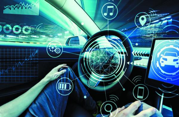 Пассажир управляет информационно-развлекательной системой беспилотного автомобиля
