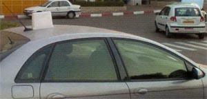 Шестилучевая наружная следящая антенна, установленная на легковом автомобиле. Диапазон частот 2,3 ГГц.